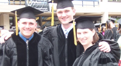 [Andy, Jer, and Steph in regalia]