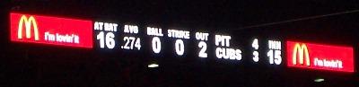 [Left field scoreboard]