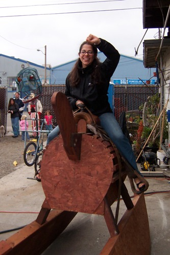 [Melissa on the giant rocking horse at the Life Size Mouse Trap]